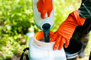 farmer mixing pesticide
